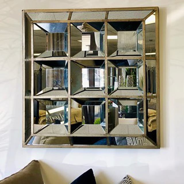 silver square mirror installed on the wall